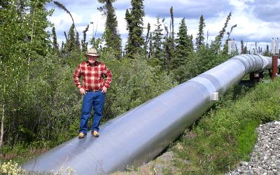 Lamar Steen Standing on Alaska Pipeline